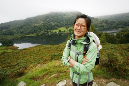Smiling East Asian Woman hiking in Lake District, Cumbria, UK. Stock Photo - 24054130