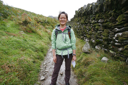Smiling East Asian Woman hiking in Lake District, Cumbria, UK. Stock Photo - 24048377
