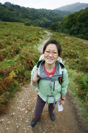 Smiling East Asian Woman hiking in Lake District, Cumbria, UK.    Stock Photo - 24048165