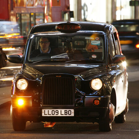 hackney carriage: London, UK - December 4, 2013: London Taxi, TX4, also called hackney carriage, black cab. Traditionally Taxi cabs are all black in London but now produced in various colors. TX4 is manufactured by the London Taxis International, LTI.
