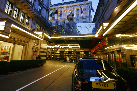 glitzy: London, UK - March 7, 2014 :Outside view of the Savoy hotel, Britains first luxury hotel in central London, opened in 1889 and closed in 2007 for renovations and reopened in October 2010.