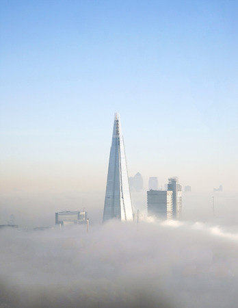 bird 's eye view: The Shard and some skyscrapers in fog seen from London Eye  Stock Photo
