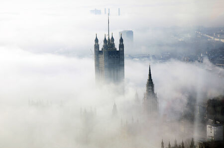 winter palace: Victoria Tower of Palace of Westminster in fog seen from London Eye