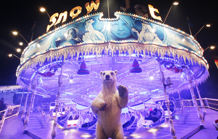 hyde: London, UK - November 26, 2013: Night scene of Hyde Parks winter wonder land, People can enjoy the rides and attractions in the famous Winter wonderland, take place yearly, at Hyde park, London