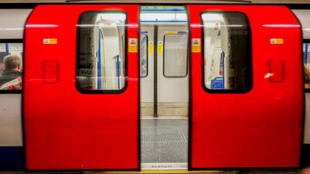 stopped: Inside view of London Underground, Tube Station, train stopped opening the door