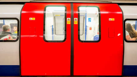 capital cities: Inside view of London Underground, Tube Station, train stopped opening the door