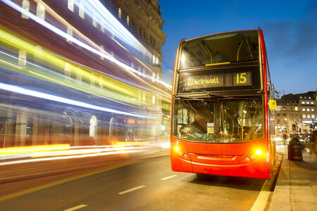 double decker: Double Decker Bus, most iconic symbol of London, at Strand at Night. Stock Photo