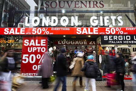 bargain hunting: London, UK - January 19, 2015:  The famous Oxford Street, people present,  pack with crowds of tourists and locals doing their big January shopping.