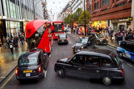 LONDON - NOV 22 : Christmas Lights Display, buses and taxis present on November 22, 2014, London, UK. The modern colorful Christmas lights attract and encourage people to the street.