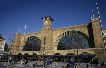 London, UK - Feb 16, 2015:  outside view of Kings Cross train station, people present, opened 1852, also called London St Pancras International railway station, home of the Eurostar.