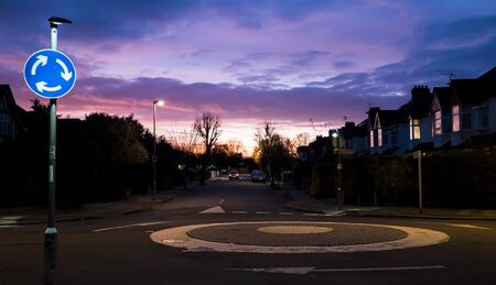 roundabout: General View of the UK Roundabout, residential area in the evening, houses present Stock Photo