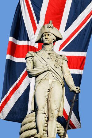 Nelson statue over Union Jack in Trafalgar Square photo