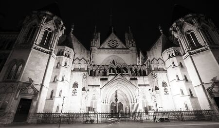 solicitors: Night view of Royal Courts of Justice in London