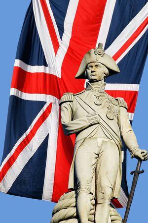 nelson: Nelson statue over Union Jack in Trafalgar Square