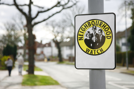 looking at watch: Neighbourhood watch area sign in England, UK
