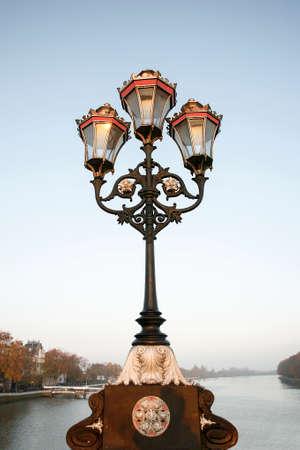 putney: Lamppost  on Putney Bridge, morning,  London
