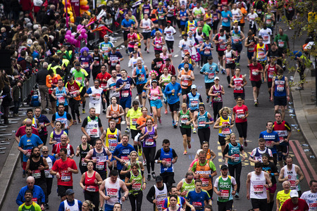 London, UK - April 26, 2015: Runners in London Marathon. The London Marathon is next to New York, Berlin, Chicago and Boston to the World Marathon Majors, the Champions League in the marathon.