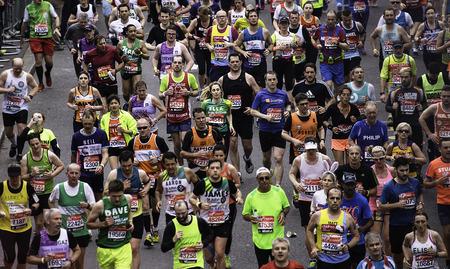 majors: London, UK - April 26, 2015: Runners in London Marathon. The London Marathon is next to New York, Berlin, Chicago and Boston to the World Marathon Majors, the Champions League in the marathon.