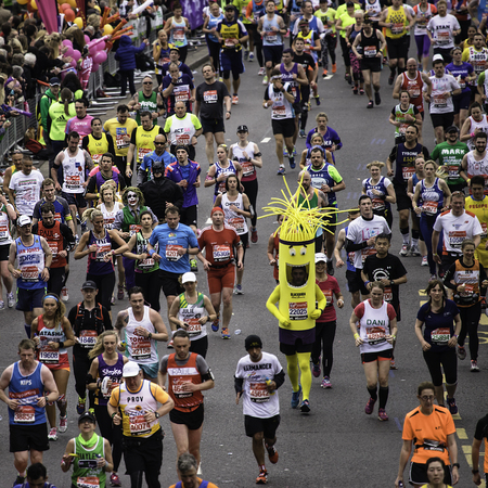 majors: London, UK - April 26, 2015: Participant wearing funny costume in the crowds of runners of London Marathon. The London Marathon is next to New York, Berlin, Chicago and Boston to the World Marathon Majors, the Champions League in the marathon. Editorial