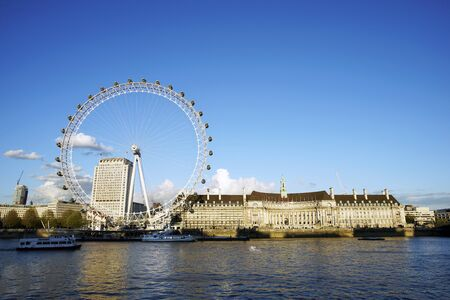 millennium wheel: LONDON - APRIL 29 : View of The London Eye on April 29, 2015 in London, UK. A famous tourist attraction at a height of 135 metres (443 ft) and the biggest Ferris wheel in Europe. Editorial