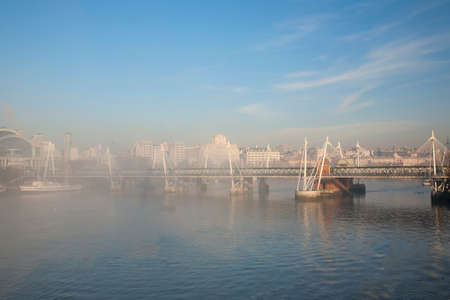 river scape: London skyline in fog, birds eye view, include Hungerford Bridge, seen from the sky