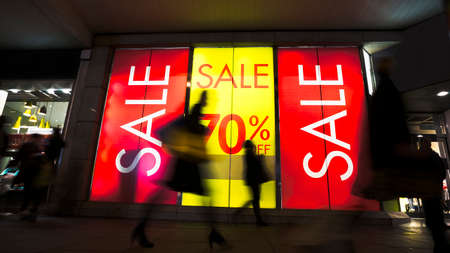 sale shop: Sale signs in shop window, include silhouette of shoppers