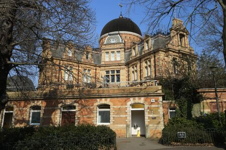 royal: London , UK - March 17, 2016: Outside view of the Royal Observatory, built in 1676, on a hill in Greenwich Park, worked in the history of astronomy and navigation.