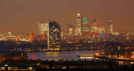 London Skyline seen from Greenwich Park. Overlooking Canary Wharf with Maritime Museum.