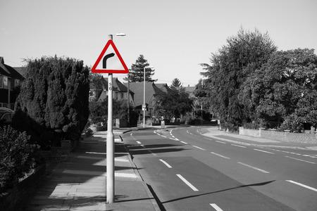 curve road: UK, Road Traffic Sign, Dangerous Curve Ahead Stock Photo