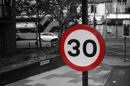 mph: UK, Road Traffic Sign, Speed Limit 30 Mph on street view background