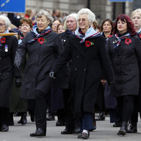 London, UK - November 8, 2015: People take part in Remembrance Day, Poppy Day or Armistice Day, nearst Sunday of 11 every Nov, observed by Commonwealth of Nations, to remember armed forces who have died since First World War.