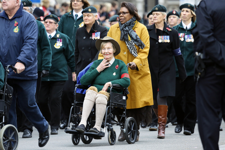first nations: London, UK - November 8, 2015: People take part in Remembrance Day, Poppy Day or Armistice Day, nearst Sunday of 11 every Nov, observed by Commonwealth of Nations, to remember armed forces who have died since First World War.