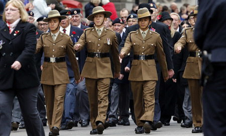 armistice: London, UK - November 8, 2015: People take part in Remembrance Day, Poppy Day or Armistice Day, nearst Sunday of 11 every Nov, observed by Commonwealth of Nations, to remember armed forces who have died since First World War.