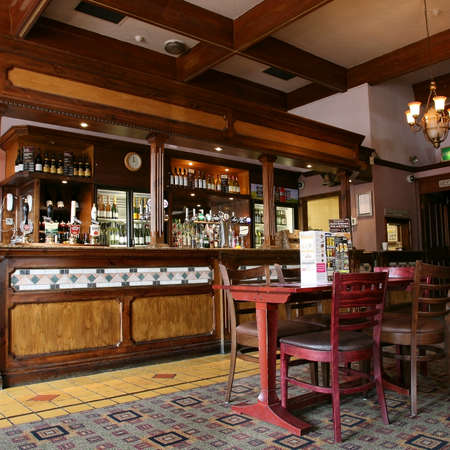 London, UK - September 02, 2010: Inside view of a public house, known as pub, for drinking and socializing, is the focal point of the community, Pub business has been declining every year.