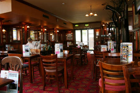 London, UK - August 26, 2010: Inside view of a public house, known as pub, for drinking and socializing, is the focal point of the community, Pub business has been declining every year. Editorial