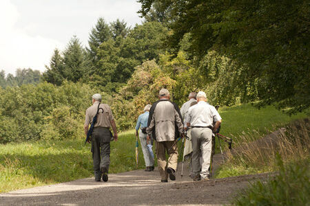migrate: Group of pensioners hiking