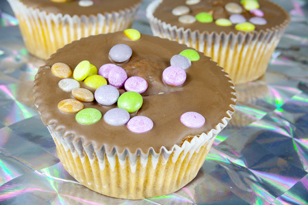 smarties: Cupcake muffin with chocolate and smarties