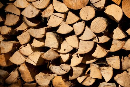 Firewood logs as background pattern