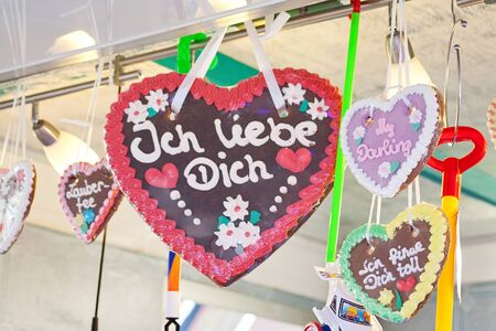 Gingerbread heart in german tradition christmas market. Text translation I love you