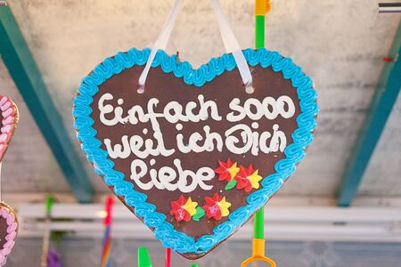Gingerbread heart in german tradition christmas market. Text translation just because i love you