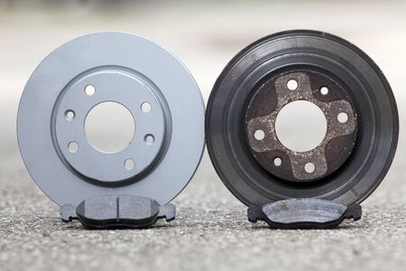 Car brake disk and pad. old used and new to change for safety