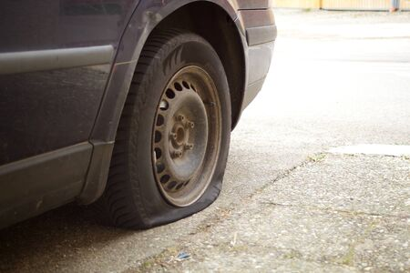 Flat tire, damaged wheel on car lost aerial Stock Photo
