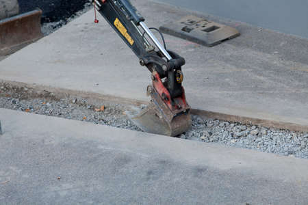 Road construction with excavator. street building Stock Photo