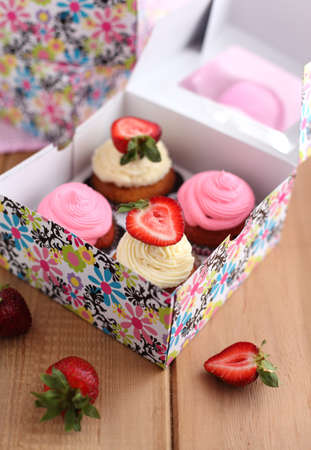 fancy sweet box: Assorted cupcakes in the colorful paper box