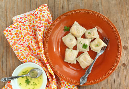 Squash ravioli with butter sauce Stock Photo - 15654985