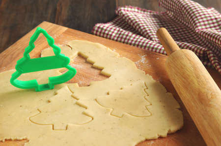 wood cutter: baking background with dough and cookie cutters