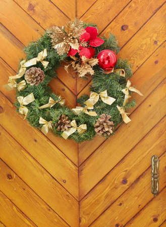 Christmas wreath on a wooden door photo