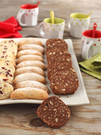 Crescents vanilla and almond cookies, Chocolate salami and Pecan cookies with cherries photo