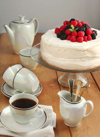 Meringue cake with berries  photo