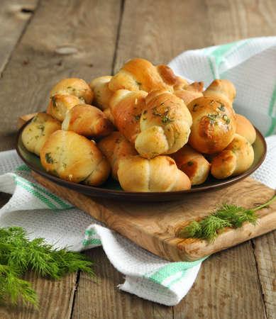 Garlic bread buns seasoned with dill Фото со стока